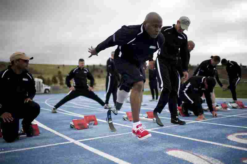 Army Warrant Officer Johnathan Holsey leaves his starting position during track practice at the Air Force Academy in Colorado Springs, in preparation for the Warrior Games.
