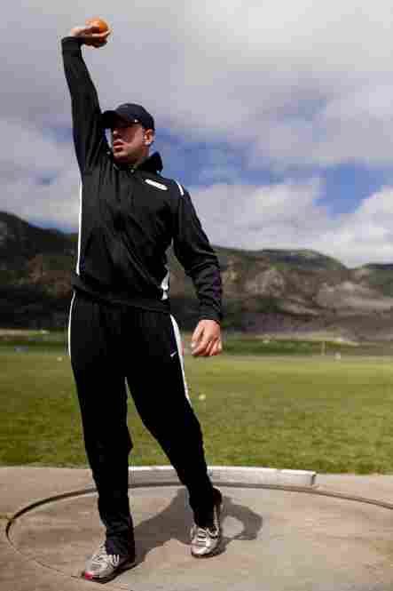 Army Sgt. Robert Laux, who is currently being treated at Walter Reed Medical Center, practices shot put at the Air Force Academy.