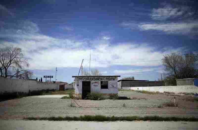 An abandoned police sub-station at El Porvenir, in Mexico's Juarez Valley. Amid a fight by drug cartels, hundreds of families are fleeing the cotton-farming towns of the valley, a stretch of border 50 miles east of Ciudad Juarez. Mexican drug cartels are terrorizing residents, emptying the area.