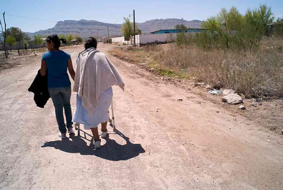 A woman (right), whose son was kidnapped and executed in August 2009, is one of thousands of people living in the Juarez Valley. Like many, she said she feels trapped there.