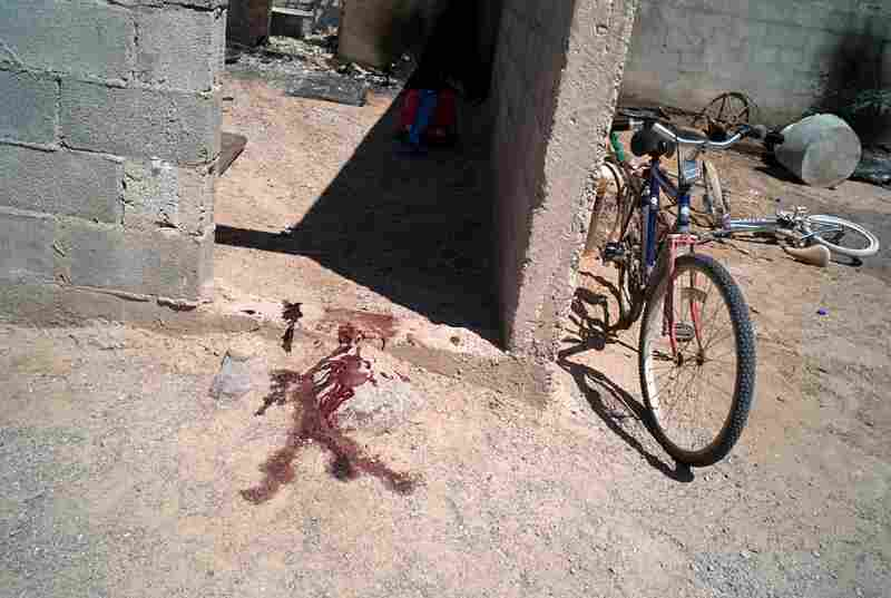 Blood stains from the site where a man was murdered in the border town of La Esperanza in Juarez Valley.