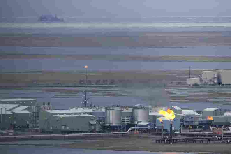 An oil facility burns excess gas on the western side of the Prudhoe Bay oil field. It is one of many similar industrial structures stretching for more than 60 miles along the coastal planes. Nearby, the native town of Nuiqsut is suffering from bad air quality as a result of the pollutants.