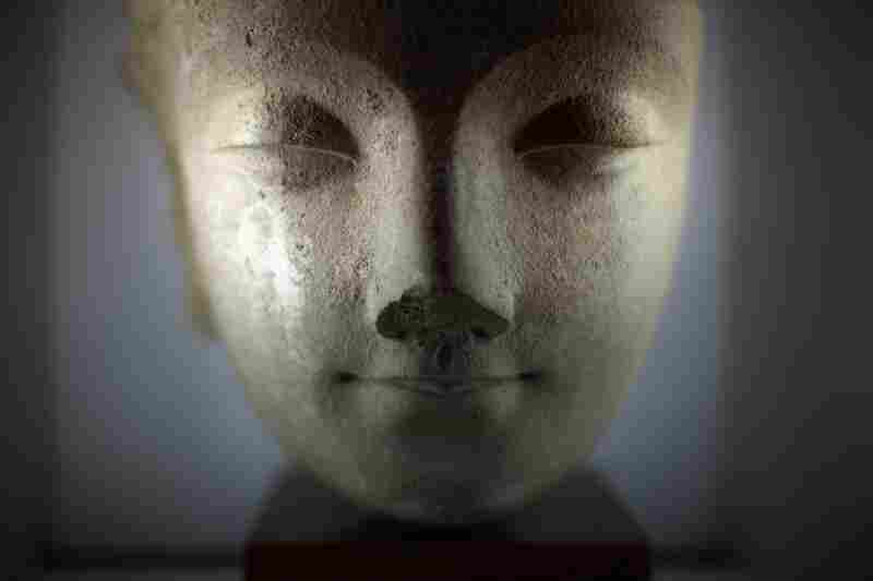 An ancient head of Buddha is on display at the Taxila Museum.