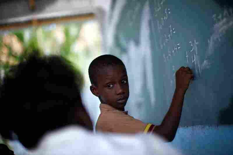 Lochard Samael works on a math problem with his teacher.