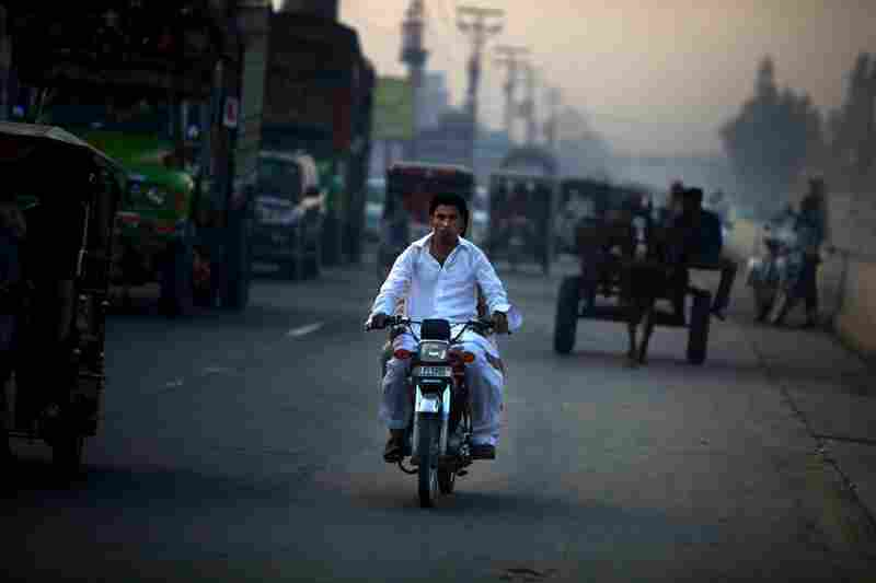 A motorist travels down the road in Lahore.