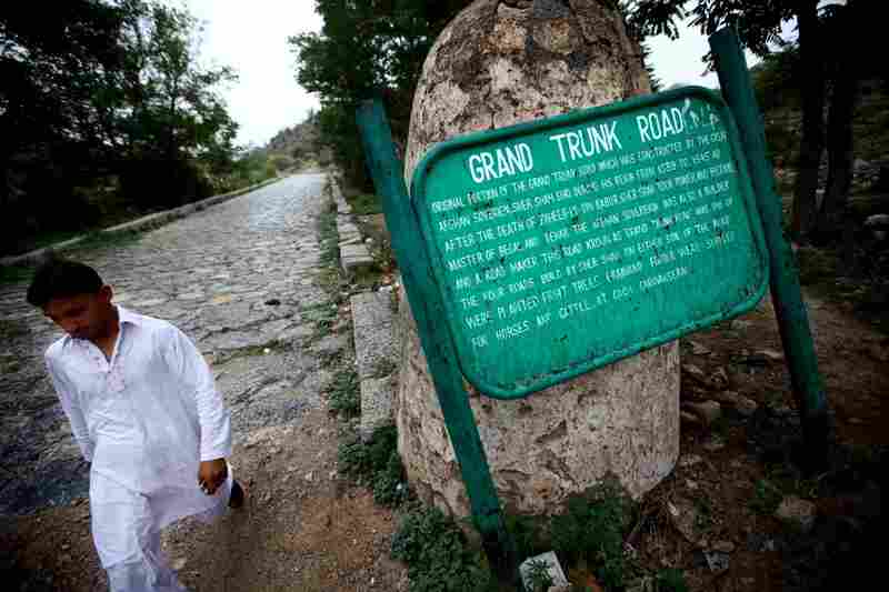 A sign in Taxila, Pakistan, memorializes an ancient cobblestoned section of the Grand Trunk Road. Construction of the road is credited to the 16th century Afghan sovereign Sher Shah Suri.