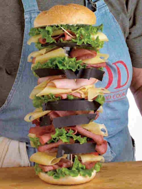 From the back, you can see the tape and toothpicks Custer uses to hold the sandwich layers in place.