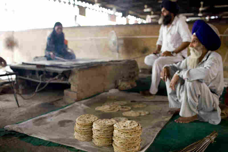 Freshly baked chapatis are ready to be served.