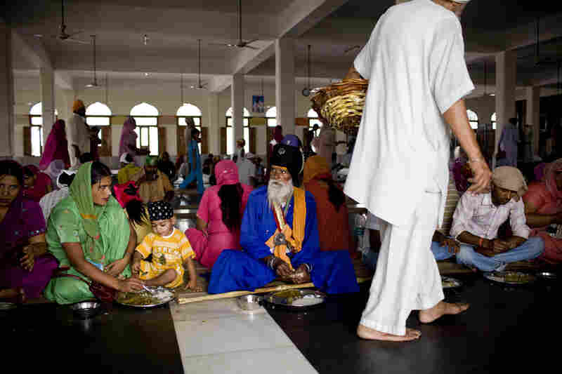 Visitors sit side by side on the floor of the Langar regardless of their caste, symbolic of the Sikh doctrine of equality of all people.
