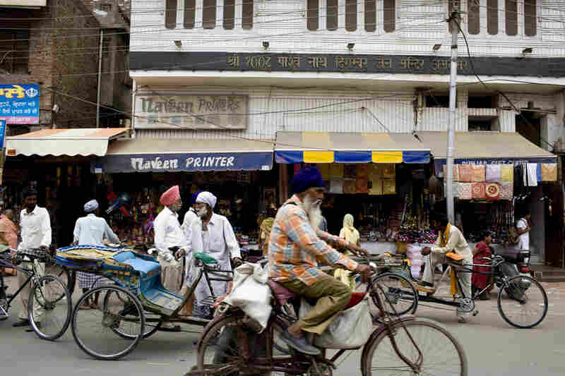 Minutes away from the Golden Temple complex, rickshaws and bicycles fill the streets of Amristar, which are dotted with shops selling everything from kites to the kara, a steel bracelet symbolizing strength and integrity.
