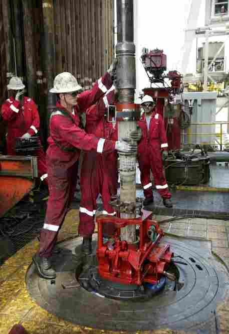 Workers adjust piping while drilling a relief well at the site of the Deepwater Horizon oil spill.