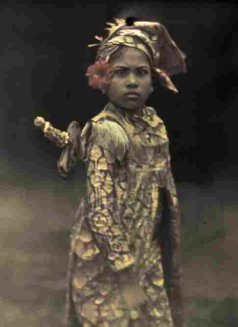 A popular child actress is costumed for the role of a mythological male warrior, Bali, 1928