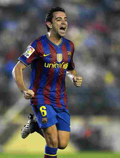 Spain's Xavi Hernandez, considered to be among the best midfielders in the game, celebrates after scoring for Barcelona against Villarreal. Spain's other top players include Fernando Torres, Andres Iniesta, David Villa, and goalkeeper/captain Iker Casillas.