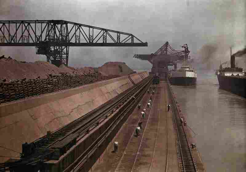 Ships approach a dock to unload iron ore in Ashtabula, Ohio, circa 1928