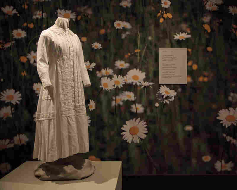 A reproduction of the white cotton dress Emily Dickinson wore while gardening, on display at the New York Botanical Garden.