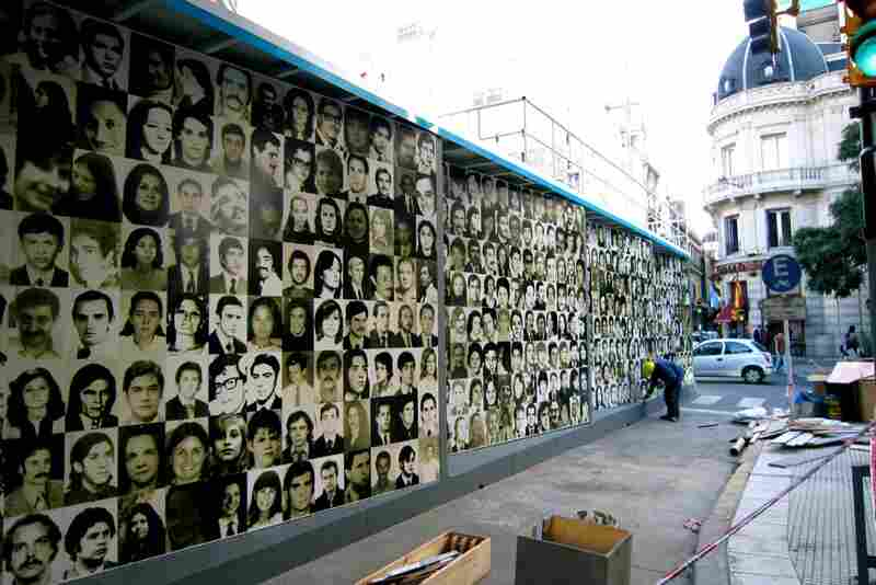 On the Grandmothers of Plaza de Mayo's pavilion, the side walls were decorated with pictures of some of the thousands of the disappeared, abducted during the 1976-1983 dictatorship.