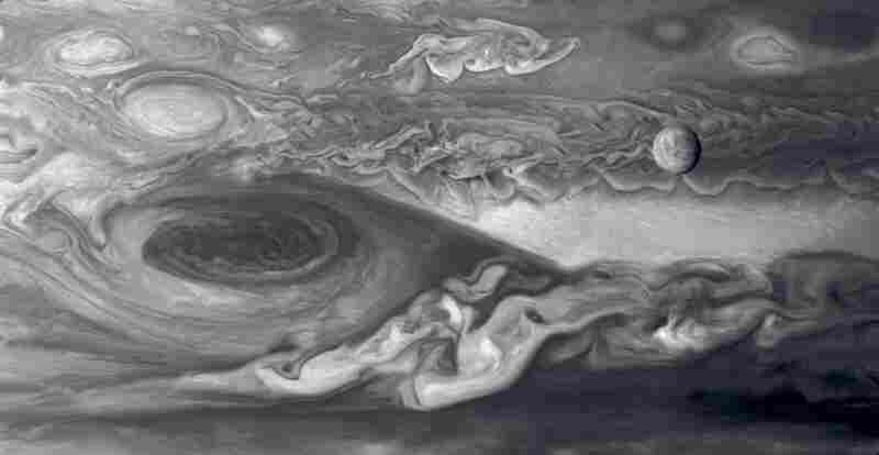 Europa And The Great Red SpotJupiter's moon Europa (upper right) is slightly smaller than Earth's moon. To the left is Jupiter's Great Red Spot, a vast cyclonic storm system about two times the size of Earth. Mosaic compiled of multiple images. Voyager 1, March 3, 1979.