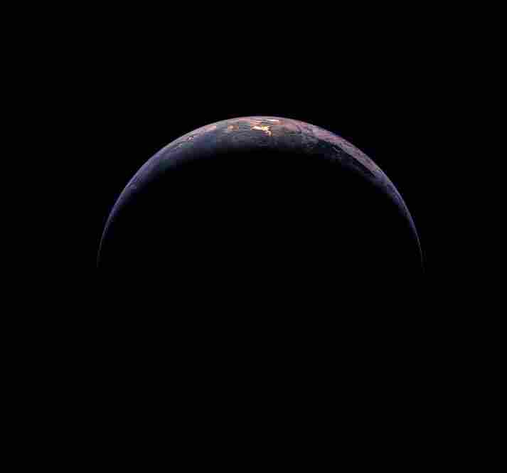 The Crescent EarthReflected sunlight glows through the clouds over the far South Pacific, where part of South America and Antarctica are visible. This image was taken from 217,500 miles away, or almost the distance to the moon. Rosetta, Nov. 13, 2009