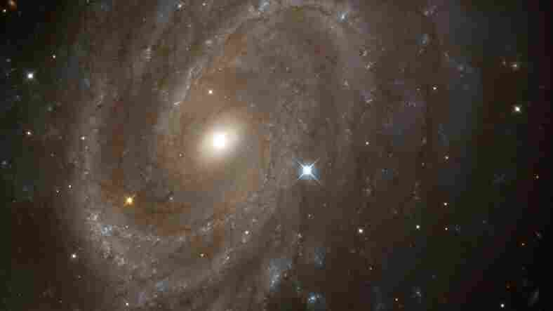 This spiral galaxy -- NGC 4603 -- was most distant galaxy helpful to the study.