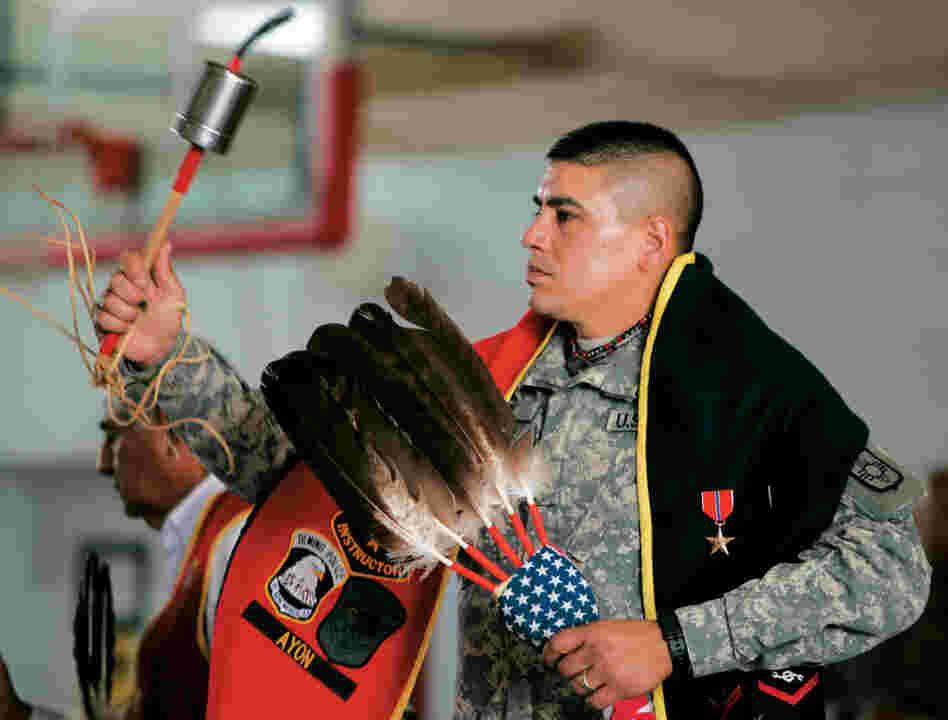 Lt. Bill Cody Ayon of the Tsitsistas, or Southern Cheyenne, participates in a Warrior Dance held at the National Guard Armory in Albuquerque, N.M. The Gourd dance blanket worn by Lt. Ayon is used to display military ribbons and awards. Ayon received a bronze star for running psychological operations in Iraq.