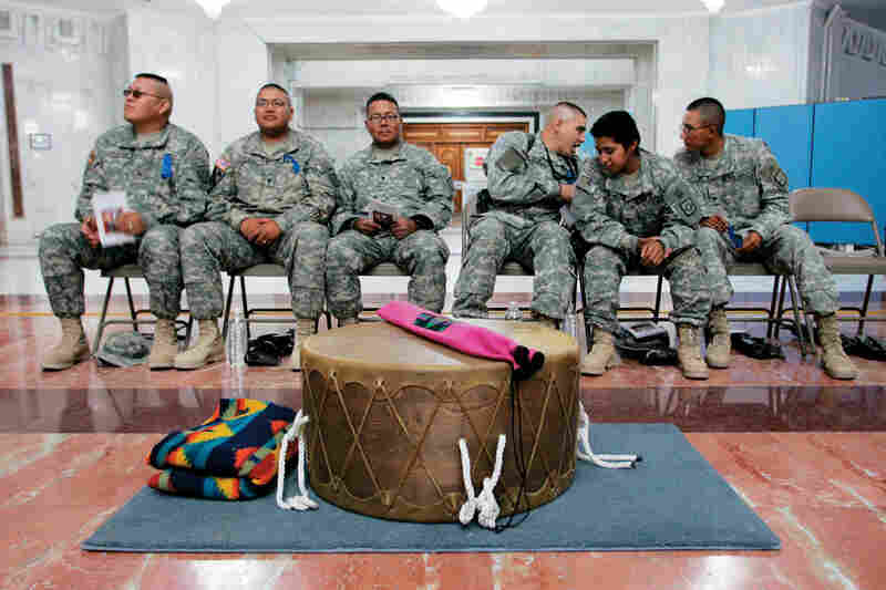 Soldiers take part in the Native American Appreciation Month celebration at Al Faw Palace in Camp Victory, Iraq on Nov. 7, 2007.