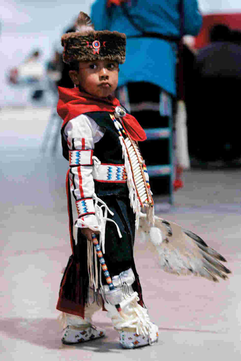 The Warrior Dance introduces young men to the warrior culture. Here, a boy in tribal costume dances in honor of Lt. Bill Cody Ayon.
