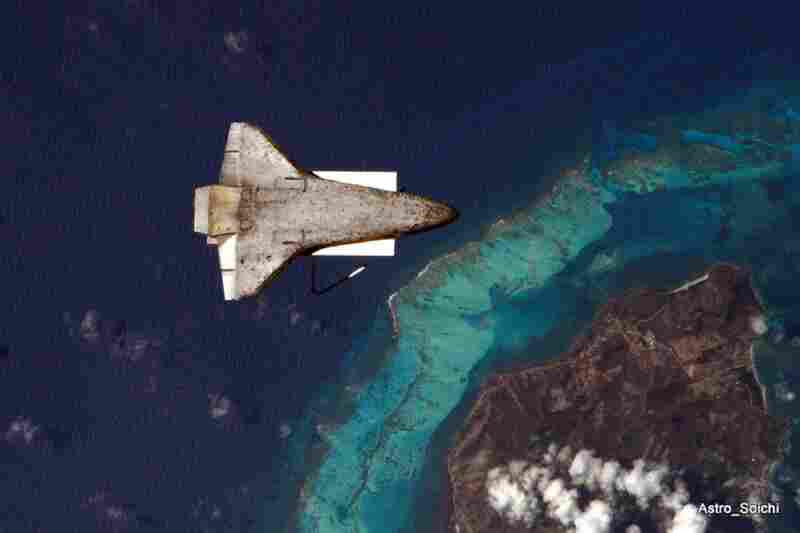 The space shuttle Discovery backs away from the International Space Station over the Caribbean in an image that Japanese astronaut Soichi Noguchi posted on April 18.