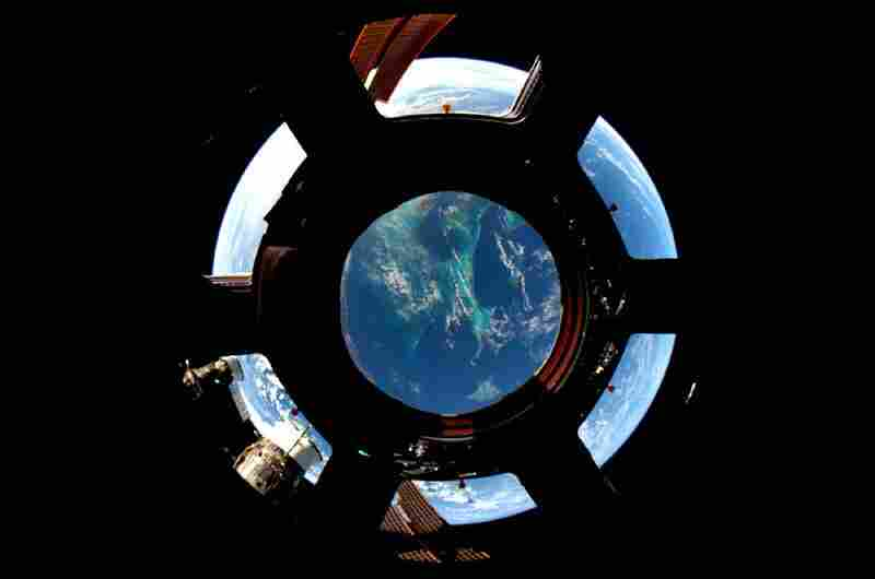 "A view of the Bahamas captured with an 8mm lens shot through the seven windows of the space station's new ""Cupola."" The new observation platform provided countless spectacular views for Noguchi's photography."