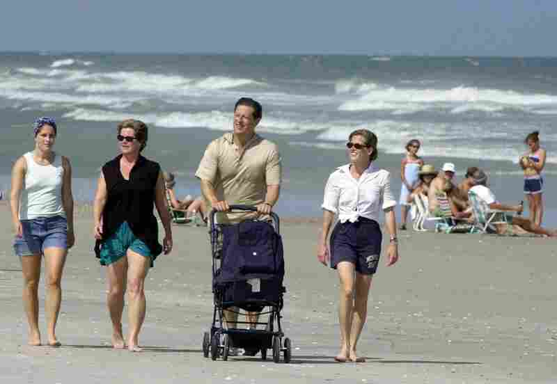 Al Gore pushes his grandson, Wyatt, as he walks along the beach with (from left) daughter Sarah, Tipper, and daughter Karenna Gore Schiff on July 31, 2000, on Figure Eight Island, N.C. The Gores have four adult children: Karenna, Kristin, Sarah and Albert III.