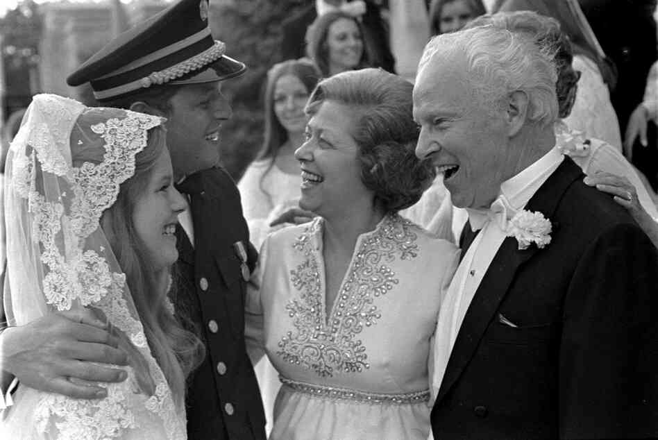 """On their wedding day, May 19, 1970, Al Gore and the former Mary Elizabeth """"Tipper"""" Aitcheson speak to Gore's parents, Albert, a senator from Tennessee, and Pauline, at Washington's National Cathedral."""