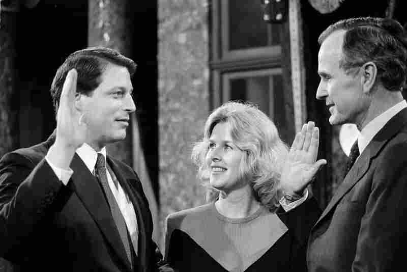 Al Gore followed in his father's footsteps to the House and then to the Senate. Here, he takes a mock oath of office from Vice President George H.W. Bush as Tipper watches during a ceremony on Capitol Hill on Jan. 3, 1985, after he was first elected to the Senate.