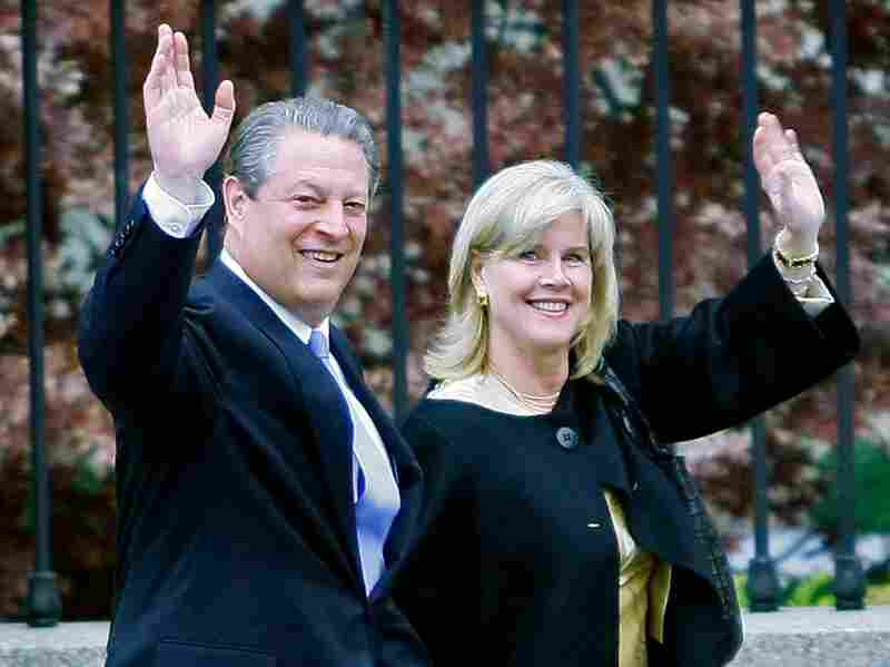 Al Gore's campaign to draw attention to climate change was also rewarded with a Nobel Prize in 2007. Here, the Gores wave after posing for photos with President George W. Bush and other Nobel winners at the White House in Washington, D.C.