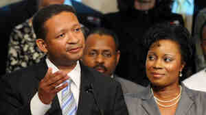 Rep. Artur Davis, with his wife Tara, concedes the Democra