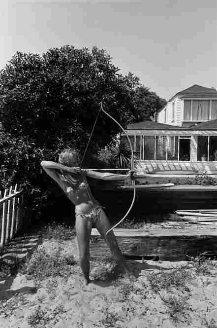 Jane Fonda with bow and arrow, Malibu, Calif., 1965