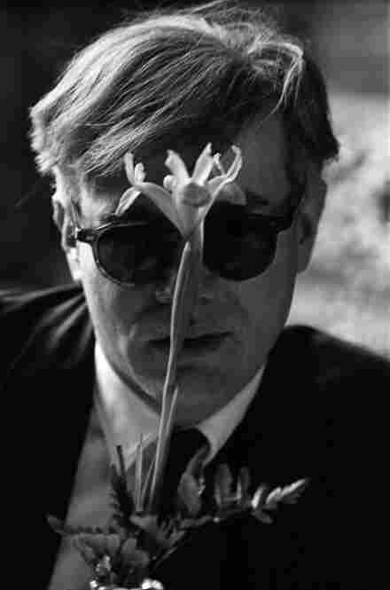 Andy Warhol with flower, 1963