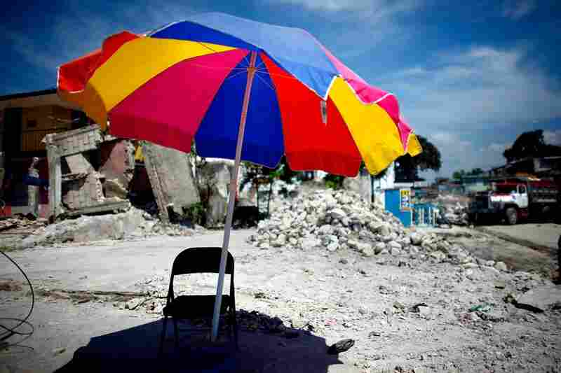 A beach umbrella and folding chair serve as a temporary guard shack in Leogane. The city is 18 miles southwest of Port-au-Prince, near the epicenter of the quake. Most of the city was destroyed.