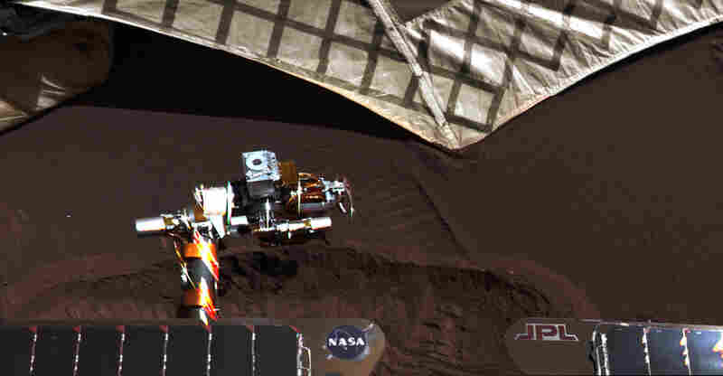 Once in a while the rovers are commanded to dig a trench with their wheels, so scientists can study the shallow subsurface. This trench, about 3 inches deep, was dug out right next to the rover's landing platform. The rover's robotic arm is extended, readying its instruments to make chemical measurements inside the trench.