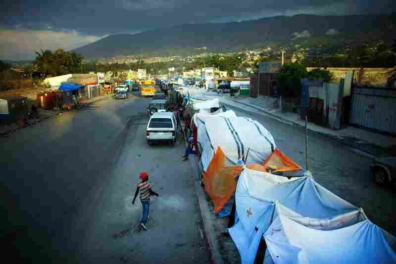About 1,000 people are living on the 8-foot-wide median of Route Nationale 2, one of the busiest roads in Haiti.
