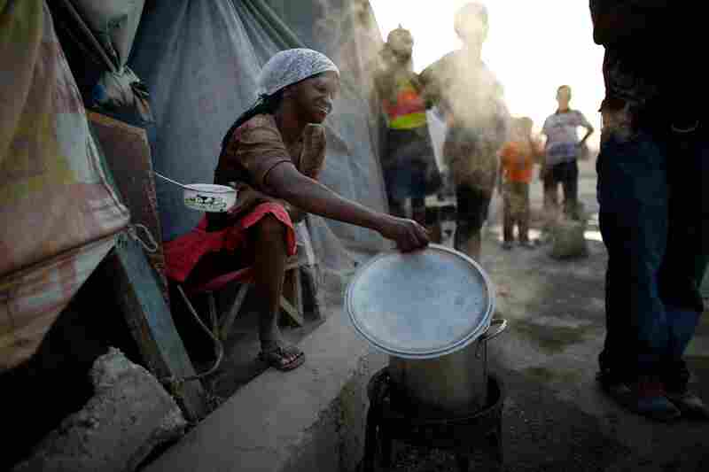 Jean, 41, cooks a meal for herself and other median residents.