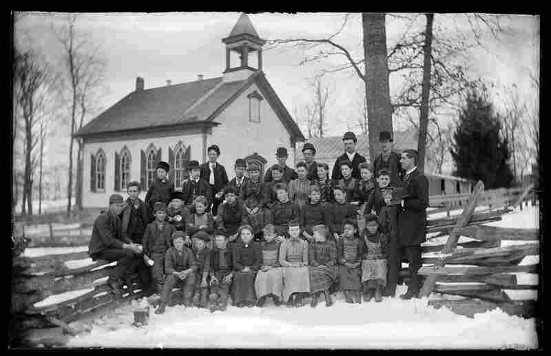 School portrait outside schoolhouse, possibly Mount Pleasant, Ohio, early 20th century, Walter J. Hussey