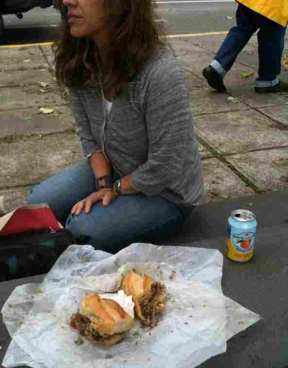Rita stops eating her sandwich.