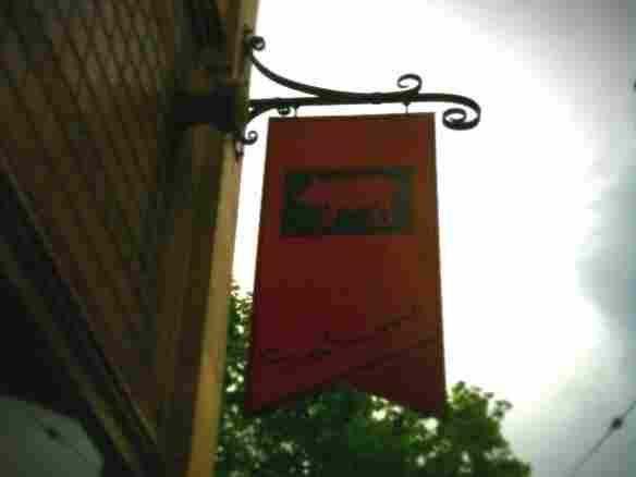 Sign on Salumi restaurant in Seattle.