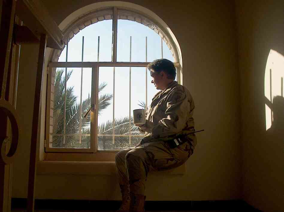In 2008, after Dyarman retired from the Army, Department of Veterans Affairs doctors linked her cognitive problems to her head traumas. Here, Dyarman drinks a cup of tea while serving in Iraq in August 2005.