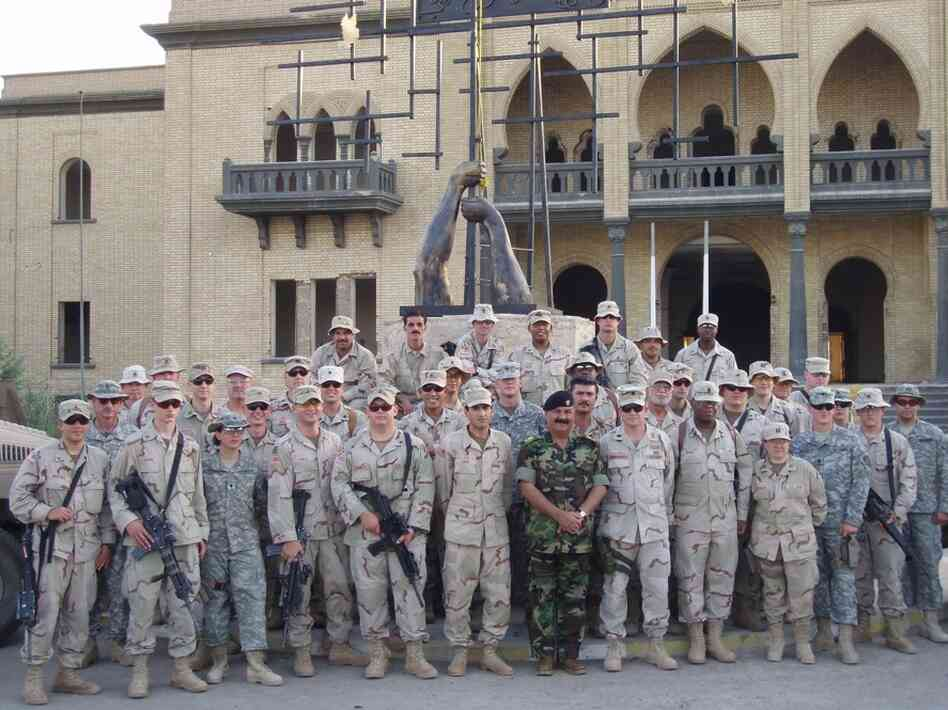 "Dyarman (first row, right) is seen with other U.S. soldiers and an Iraqi general at Tiger Base on Sept. 11, 2005. ""I served my country. Now what's my country doing for me?"" she asks."