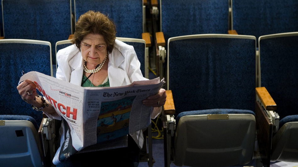 Venerable journalist Helen Thomas reads the newspaper while sitting in her chair in the White House press room. Thomas covered the White House for more than 50 years. (Getty Images)