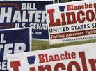 A cluster of Bill Halter and Blanche Lincoln campaign signs are displayed at an intersection.