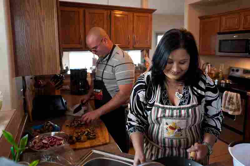 Victor Medina prepares dinner with his wife, Roxana Delgado, at their home in El Paso. Delgado was instrumental in fighting to get care for Medina, who now is improving after starting treatment at Mentis.