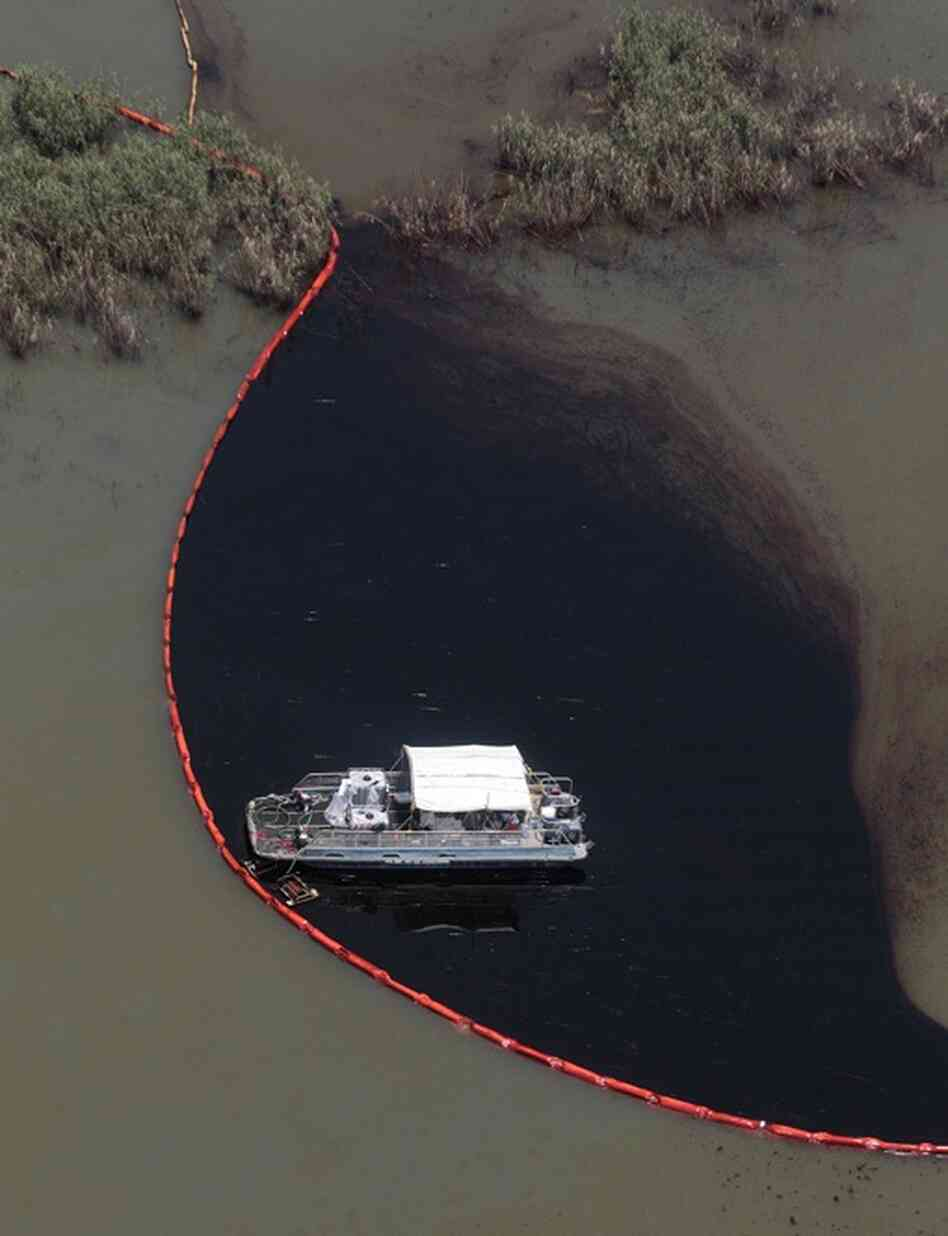 Workers clean up oil in Pass a Loutre, La.  The latest attempt to plug the leak was unsuccessful.