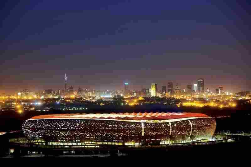 Johannesburg's new 94,000-seat stadium, inspired by the shape of a traditional African pot, sparkles against the city's skyline. With all eyes on the World Cup host, South Africa aims to dazzle: President Zuma calls 2010 the most critical year since 1994, when apartheid ended.