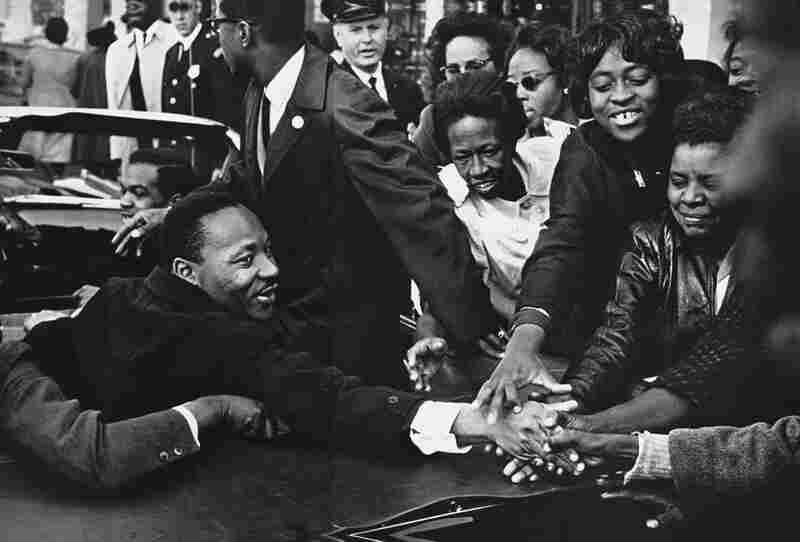 """The Reverend Martin Luther King being greeted in an open car."" Maryland"